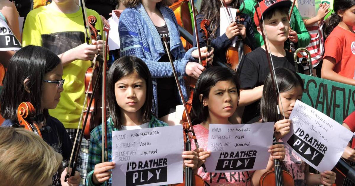Vancouver students stage silent orchestra to protest budget cuts to music programs   Georgia ...