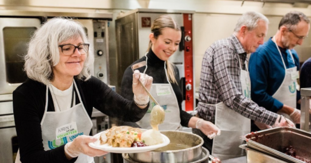 Vancouver TV anchors serve the poor at annual Union Gospel Mission Easter feast