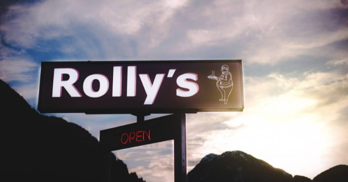Demonstrators outside Rolly's Restaurant diss media coverage of vaccine passports